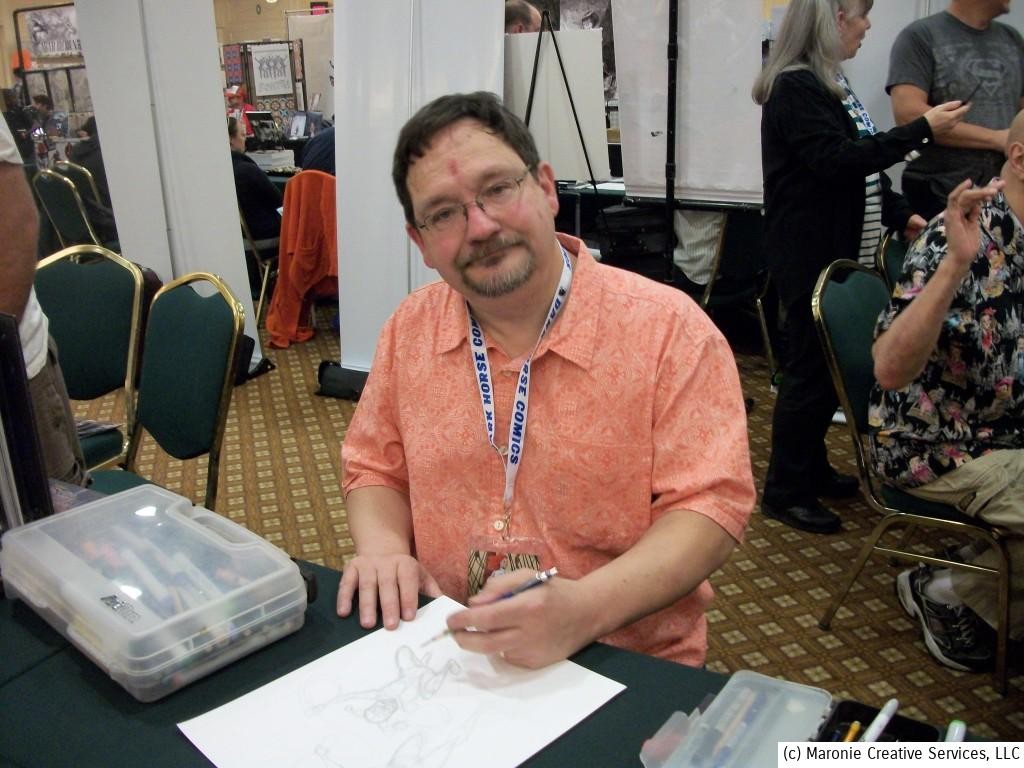 Local artist Rick Burchett had a constant stream of visitors to his table. Rick is best known for his work on Batman Adventures, Blackhawk, and many other titles for a variety of companies.