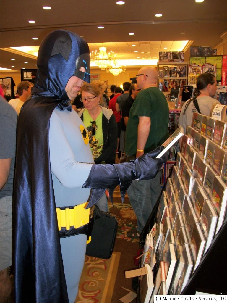 The Caped Crusader makes his selection from one of the dealer booths.......perhaps catching up on the latest issue of Spider-Man?