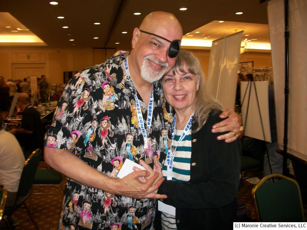 George Perez pauses from autographing and sketching to pose with his lovely wife.
