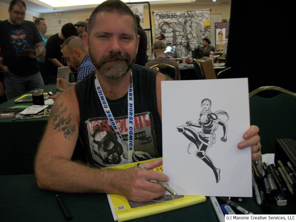 Artist Stephen Sadowski proudly shows off one of his beautiful convention drawings at Project Comicon, St. Louis, MO, September 2013.