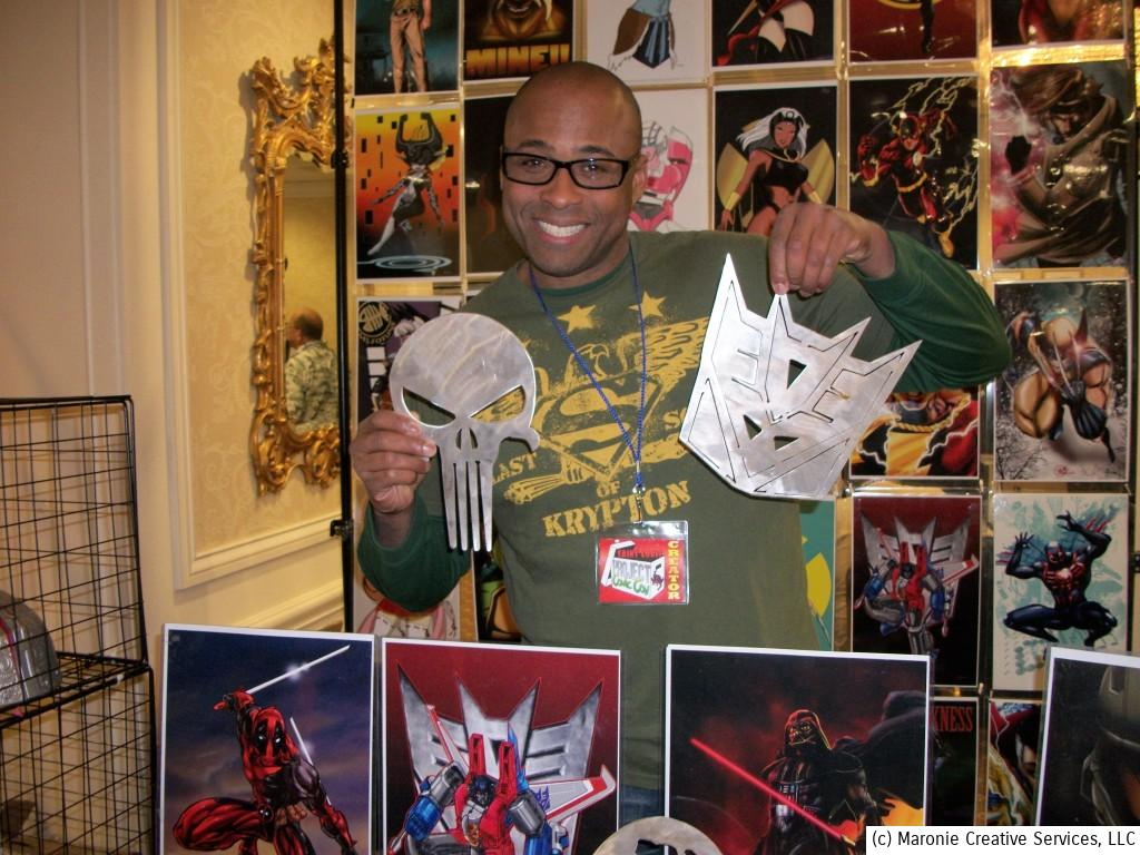 John Clark from Kansas City, Mo, shows off some of the metal insigia he has created. John often appears in costume at conventions as Green Lantern and other characters. He's also a motivational speaker and visits children's hospitals and youth groups, clad as comic book heroes while delivering a message of positiveness and encouragement.
