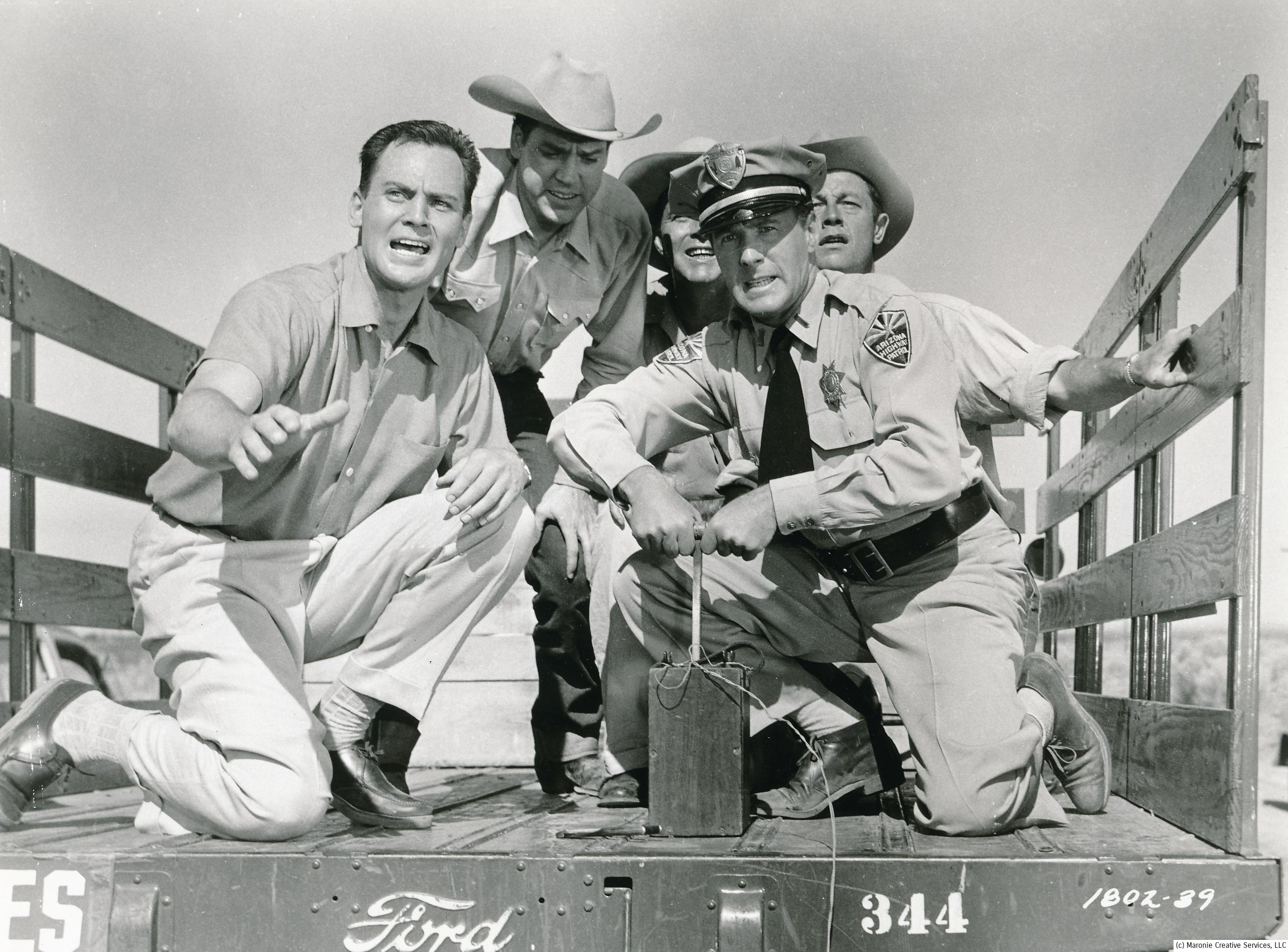 John Agar (l) and local law enforcement attempt to dynamite the oncoming monster. Needless to say, it only gave him a tickle!