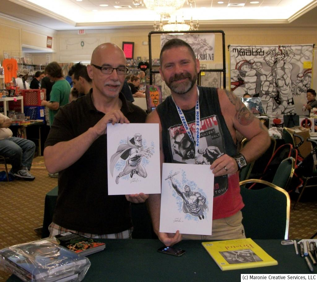 Steven Sadowski poses with Blogmeister Sam and two of his exquisite commissions at a 2013 comics convention.