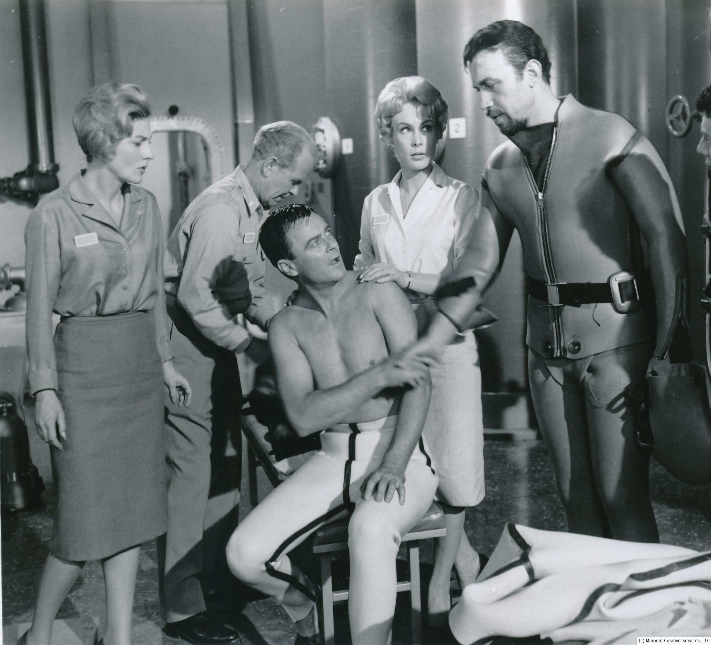 Barbara is giving real-life husband Michael Ansara a tense look in this scene from 1961's Voyage to the Bottom of the Sea. Eden said she enjoyed working for the film's producer, Irwin Allen; he used her in a couple other of his feature films for 20th Fox in the 60's. (c) 20th Century-Fox