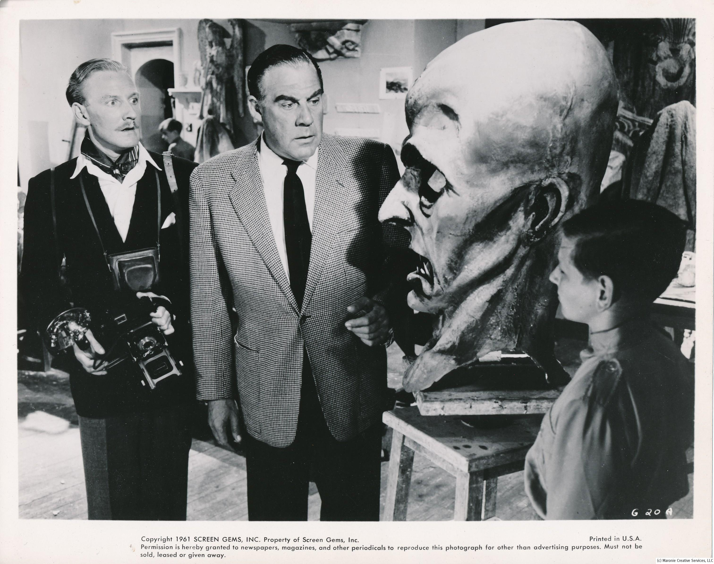 The Gamma People (1954), was a weird sci-fi opus lensed in Germany. The feature starred Paul Douglas (in suit) as an American reporter who stumbles on to an evil experiment. Believe it or not, Douglas was a big star in the 1950s. He was certainly no Clark Gable, but somehow audiences responded to his rough-hewn exterior. He excelled at portraying gangsters, thugs, and other such knuckleheads. His best-known films are A Letter to Three Wives, the original Angels in the Outfield, and Joe MacBeth. (c) Columbia