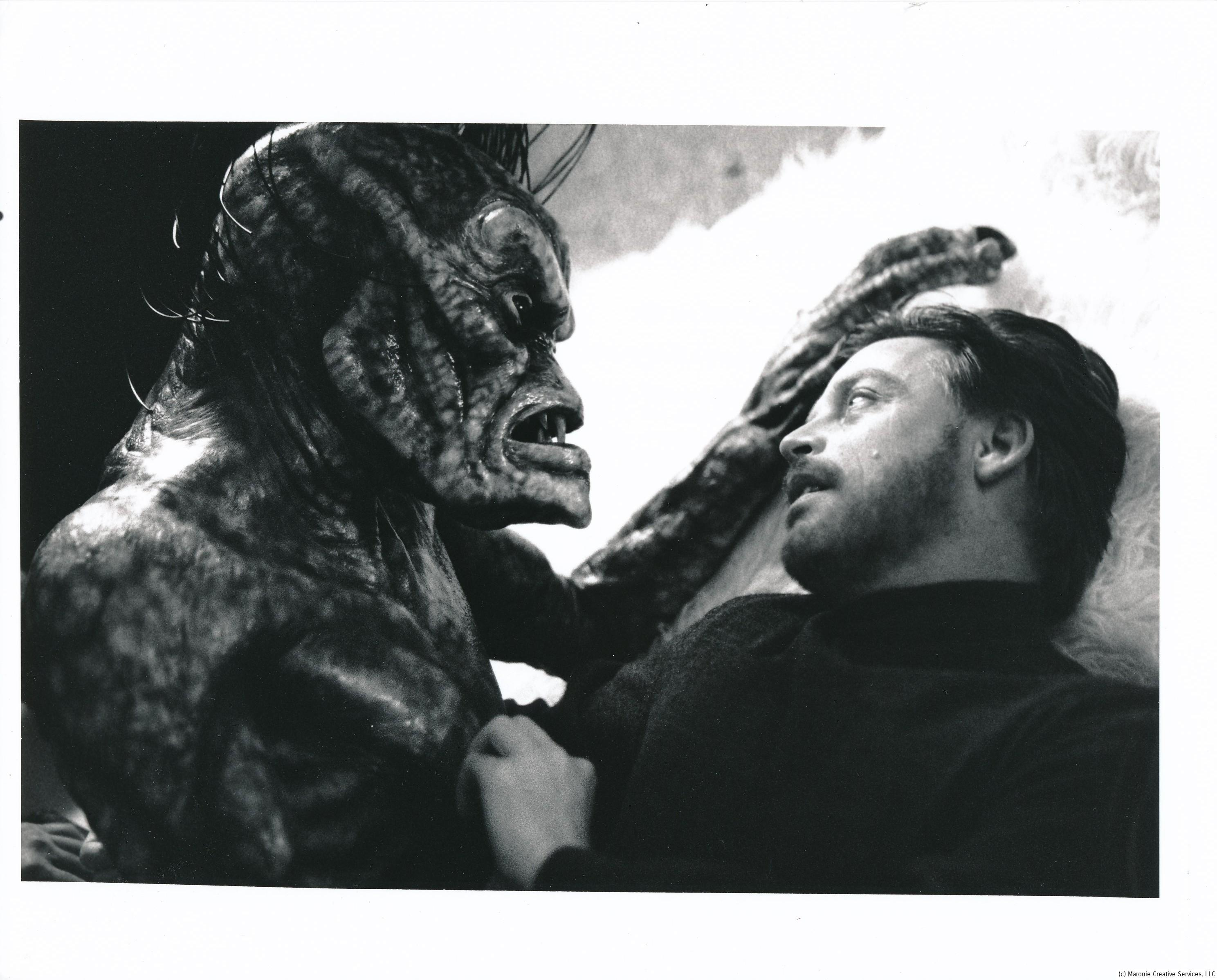 Mark Hamill stares down yet another hostile alien in a scene from the Dream Weaver episode of TVs seaQuest DSV. Where's Chewy when you need him? This series was produced by Steven Spielberg's company and ran on NBC for a couple of seasons. Viewers found it a crashing bore and the network kept it afloat solely on Spielberg's pedigree. Ah for the days of Admiral Nelson and Captain Crane! (c) Amblin/Universal Studios