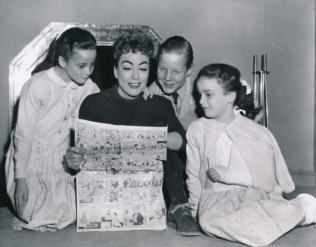 We always hear about Christina, but here's a pic of the rest of the Crawford clan in 1955. The children are 8-year-old twins, Cindy (l) and Cathy, and Christopher, 12. Fifteen year-old Christina was away at school.