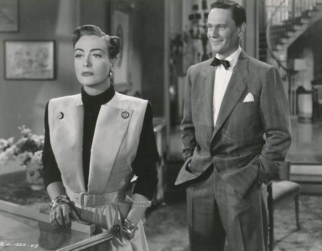 How does that saying go? Is it 'Life Imitates Art' or 'Art Imitates Life?' In any event, in the film Harriet Craig, Joan plays a wife obsessed with order, cleanliness and possessions. Many would say that Joan was just playing herself. Here's a scene from that film with Crawford and Wendell Corey. This movie was produced by William Dozier, who later went on to fame as the provider of the Batman teleseries in the 1960s. (c) Columbia Pictures