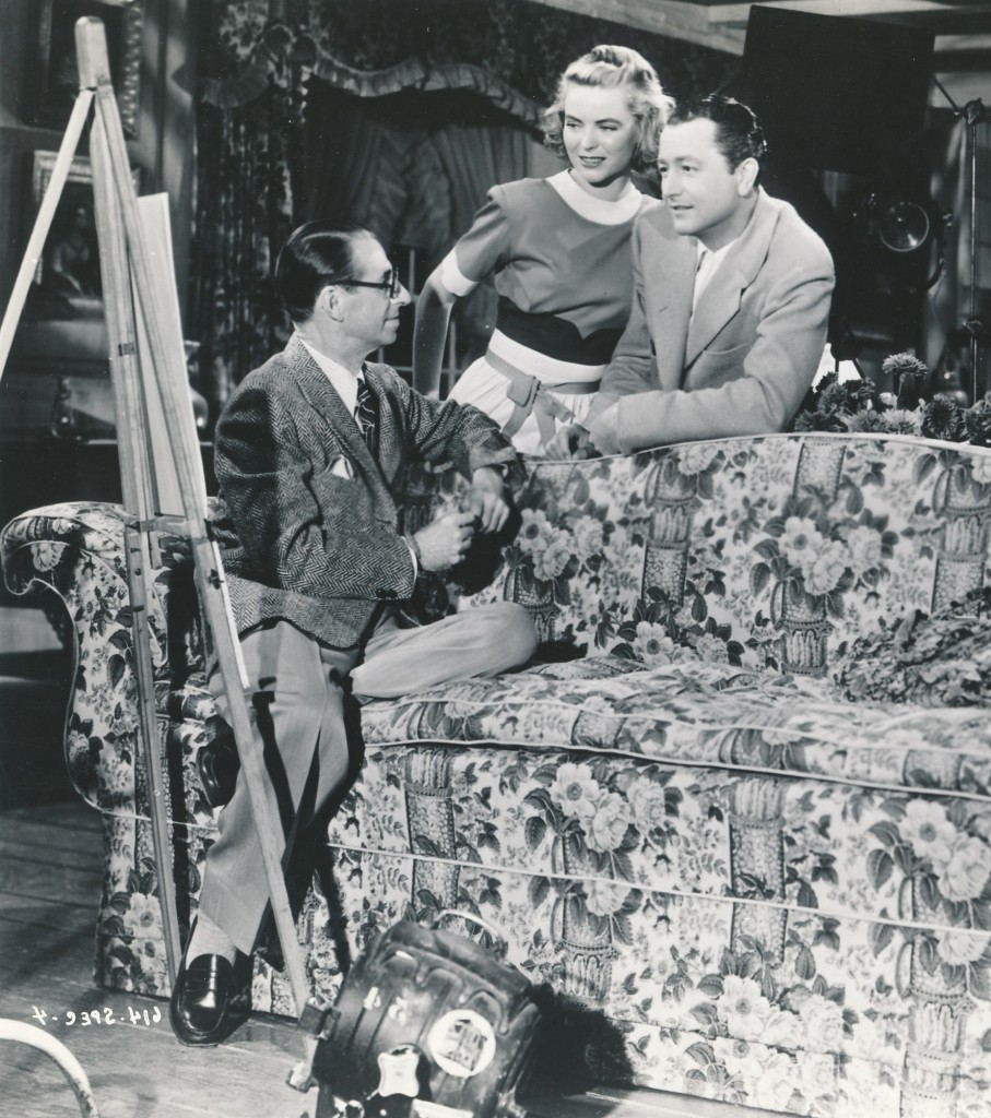 Young on the set of one of his most popular films, Claudia, with Dorothy McGuire. At left is famous director Edmond Goulding. (c) 20th Century-Fox