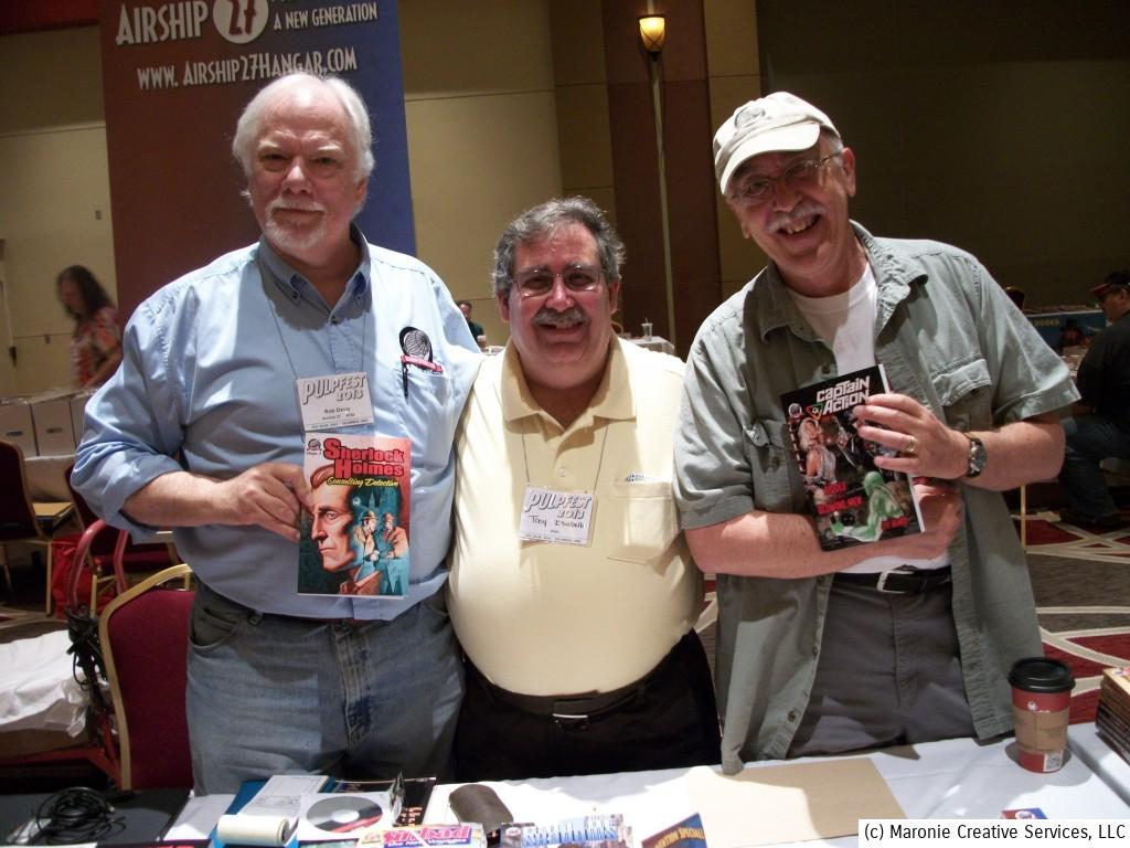 Artist Rob Davis, writers Tony Isabella and Ron Fortier show off their wares at Pulpfest 2013.