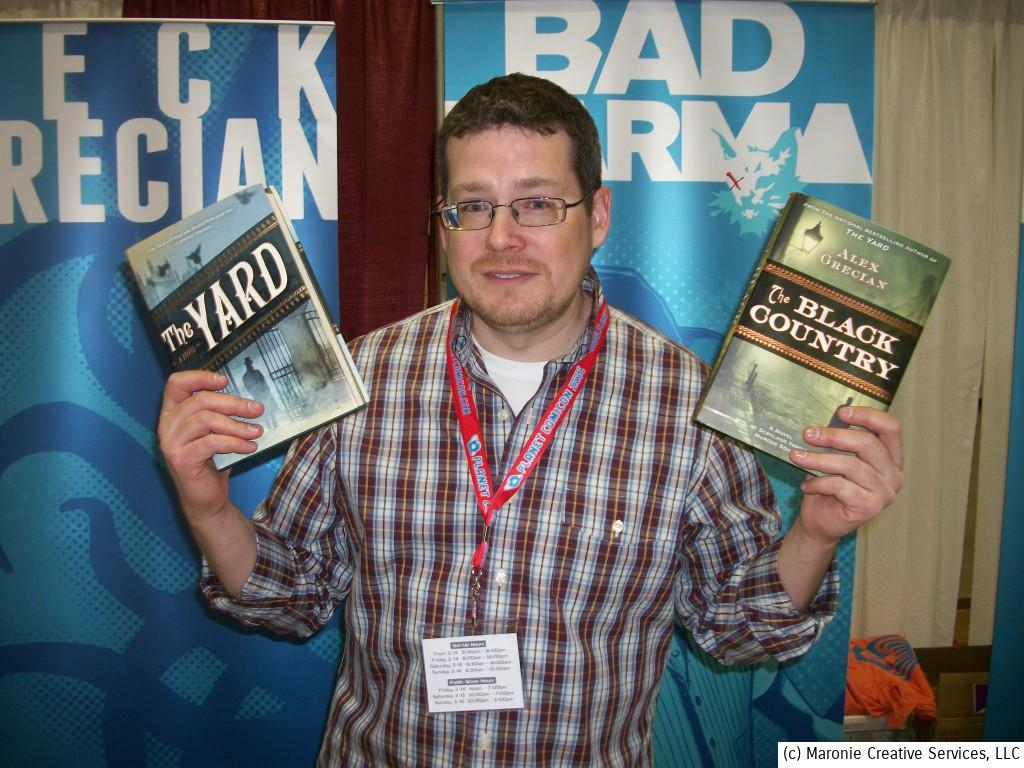 Comics writer-turned-novelist Alex Grecian shows off copies of his 'Scotland Yark' Victorian mystery stories. The author has completed #3 and at work on the fourth installment.