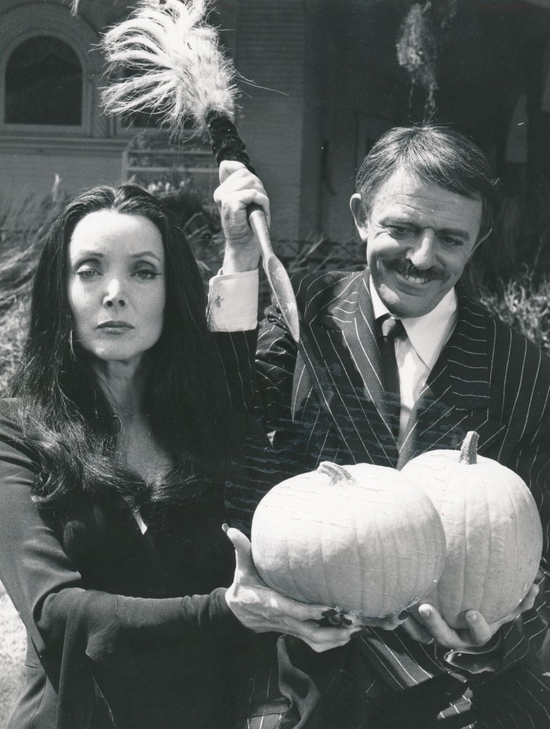 Here's another still from the 1977 Adams Family reunion TV film. Carolyn Jones and John Astin prepare to do some serious pumpking carving. They were both very nice people in real life. I met Astin once at a book signing, and he could not have been friendlier. Ms. Jones I never met, but I did write to her while she was appearing at a dinner theatre production in Chicago. I had sent her a photo to sign--which she returned--and also included a lovely handwritten letter. (c) NBC