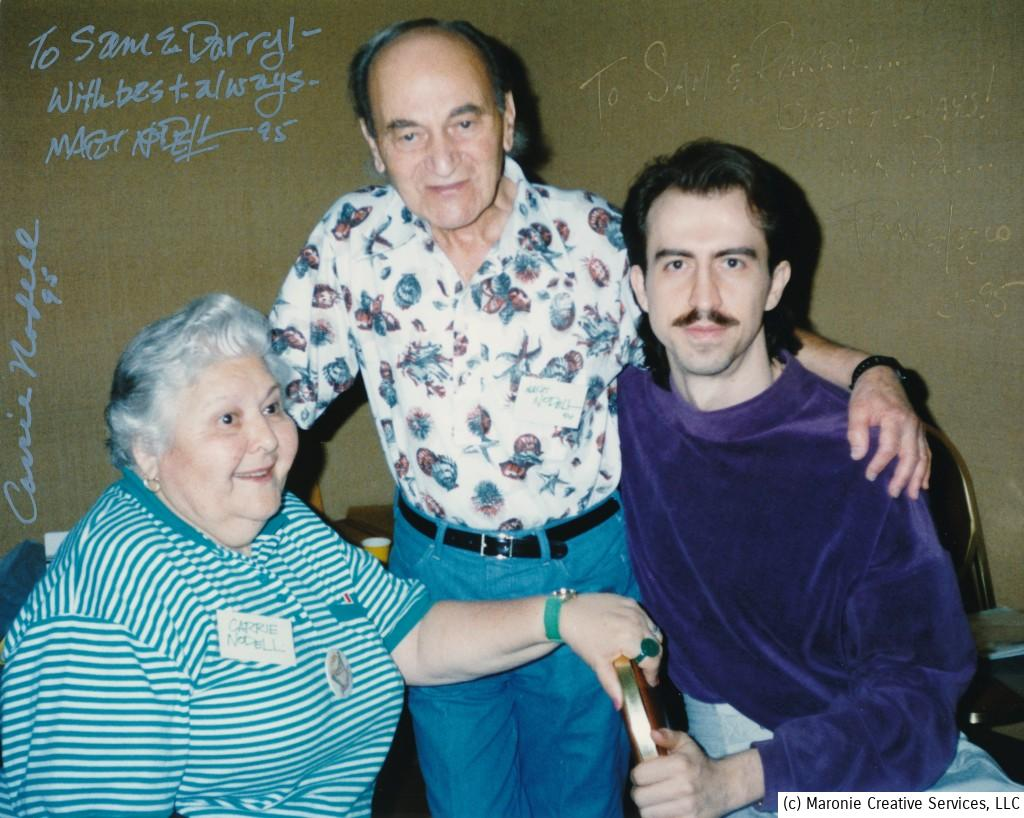 Carrie and Marty Nodell at an early-90s Kansas City, MO convention appearance. Marty''s arm is around their dear friend and very talented artist, Franchesco.