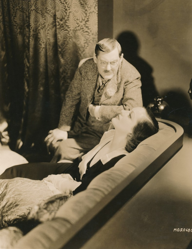 A rare photo from the 1932 MGM classic, Grand Hotel. Here the great Lionel Barrymore as Kringelein counsels Joan Crawford who portrayed Flaemmchen the lovelorn stenographer. The film boasted an all-star cast including Lewis Stone, John Barrymore, Greta Garbo and Wally Beery. It was a tremendous hit at the time of its release with Depression-era audiences and quickly became a cinema classic. The screenplay was based on Vicki Baum's best-selling novel. c) MGM