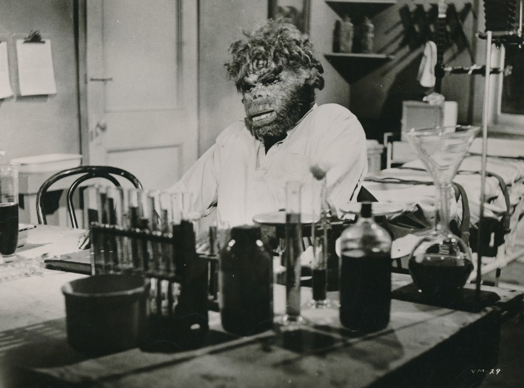 Amazing what you can do with a rubber mask and some test tubes? This still is from The Neanderthal Man (1953), starring Robert Shayne. Shayne is best known as Inspector Henderson from The Adventures of Superman TV series. The actor was in many fine films for Warner Brothers in the 40s, most notably Christmas in Connecticut with Barbara Stanwyck. (c) UA