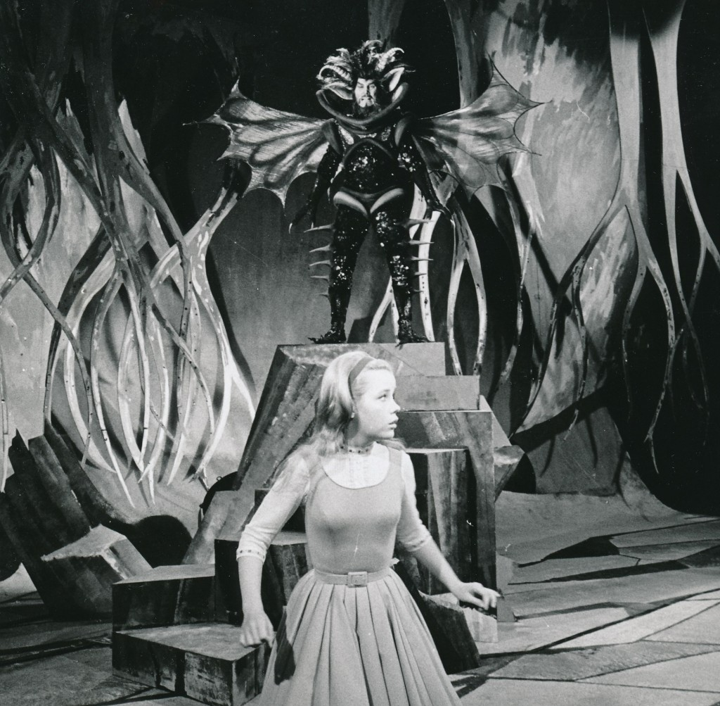 A 1960s TV production of Alice in Wonderland. That's creepy Jack Palance in the background as the Jabberwock. How the heck did he sit down in that get-up? (c) NBC