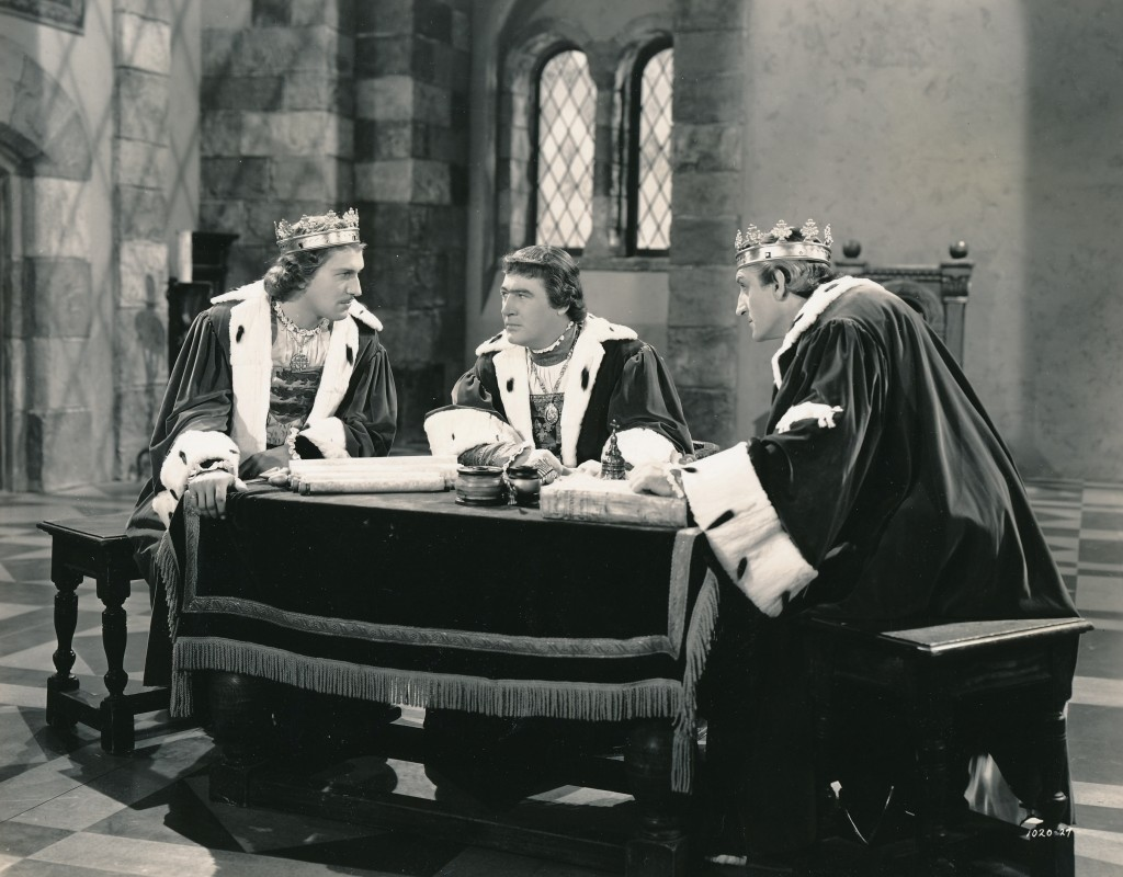 A youthful Vincent Price (l), alongside Ian Hunter (c) and Basil Rathbone confer in a scene from 1939's Tower of London. While they look nefarious here, the three actors--plus Karloff--spent much of the time kibitzing on the set and playing practical jokes on each other throughout filming. Price was freshly contracted to Universal and this was one of his earliest screen roles. (c) Universal Studios