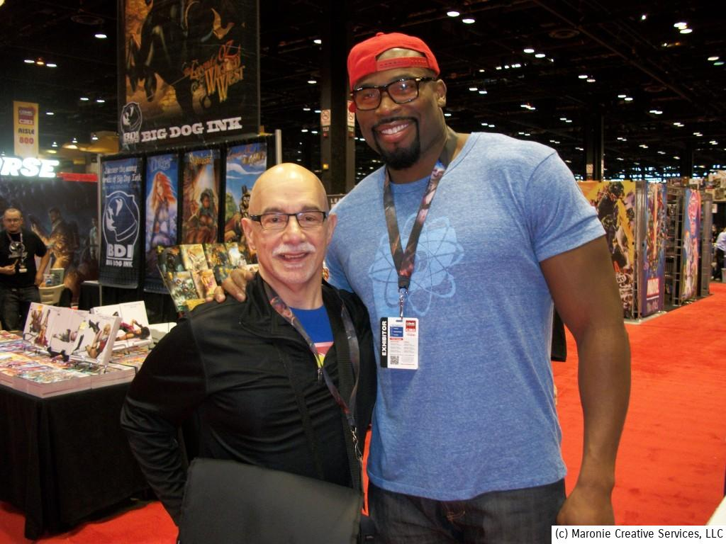 Blogmeister Sam poses with his ol' buddy, Athlita Comics publisher  and head honcho Israel Idonije. When he's not playing pro football for teams like the Chicago Bears and the Detroit Lions, Israel writes Athlita's flagship title 'The Protectors.'