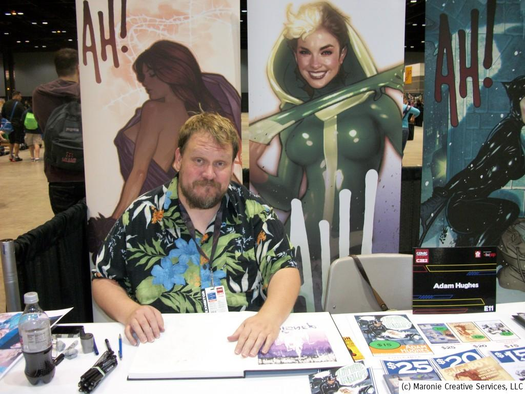 Artist Adam Hughes pauses from his work to pose for the Funhouse camera. His lines of fans never let up the whole weekend.