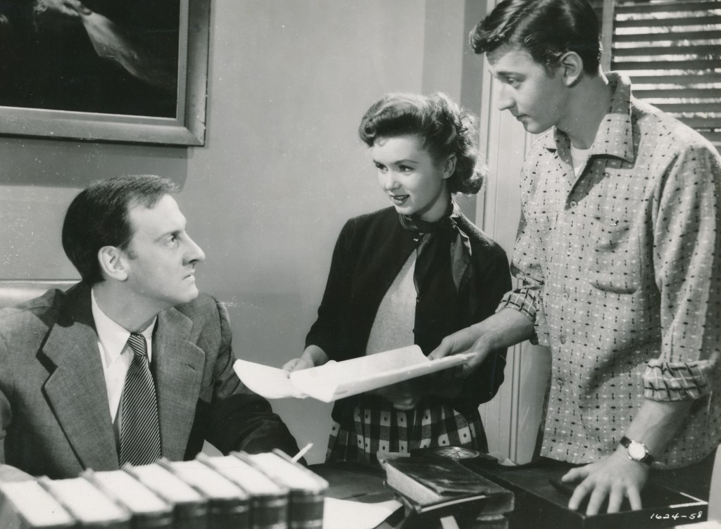 Hans Conried excelled at portraying authority figures. He portrayed teachers in many films. Here he is trying to educate Debbie Reynolds and Bobby Van in 'The Many Loves of Dobie Gillis'. (c) MGM