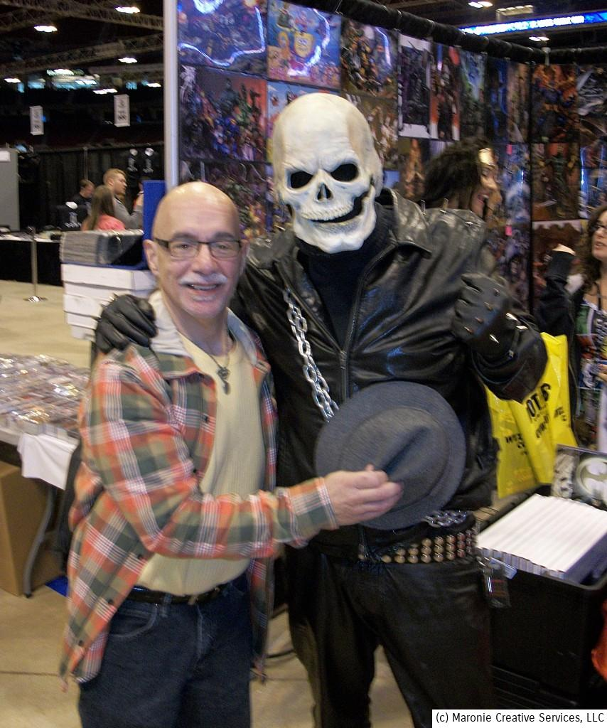No, it is not Nicholas Cage, but there was another Ghost Rider at the convention. Here he's threatening Blogmeister Sam with some other-wordly whoop-ass!