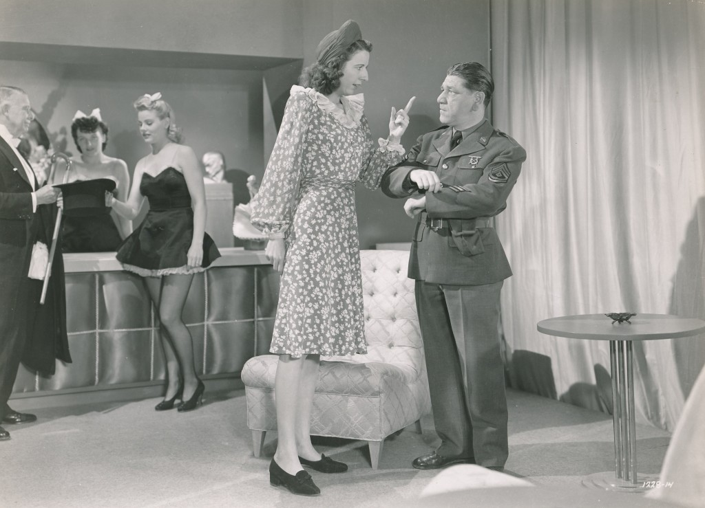 Veteran character actress Mary Wickes towers over Sgt. Shemp in this scene from the 1942 piece of wartime fluff, 'Private Buckaroo.'  Forties stalwarts Harry James and the Andrews Sisters contributed some great musical numbers in this little programmer. (c) Universal
