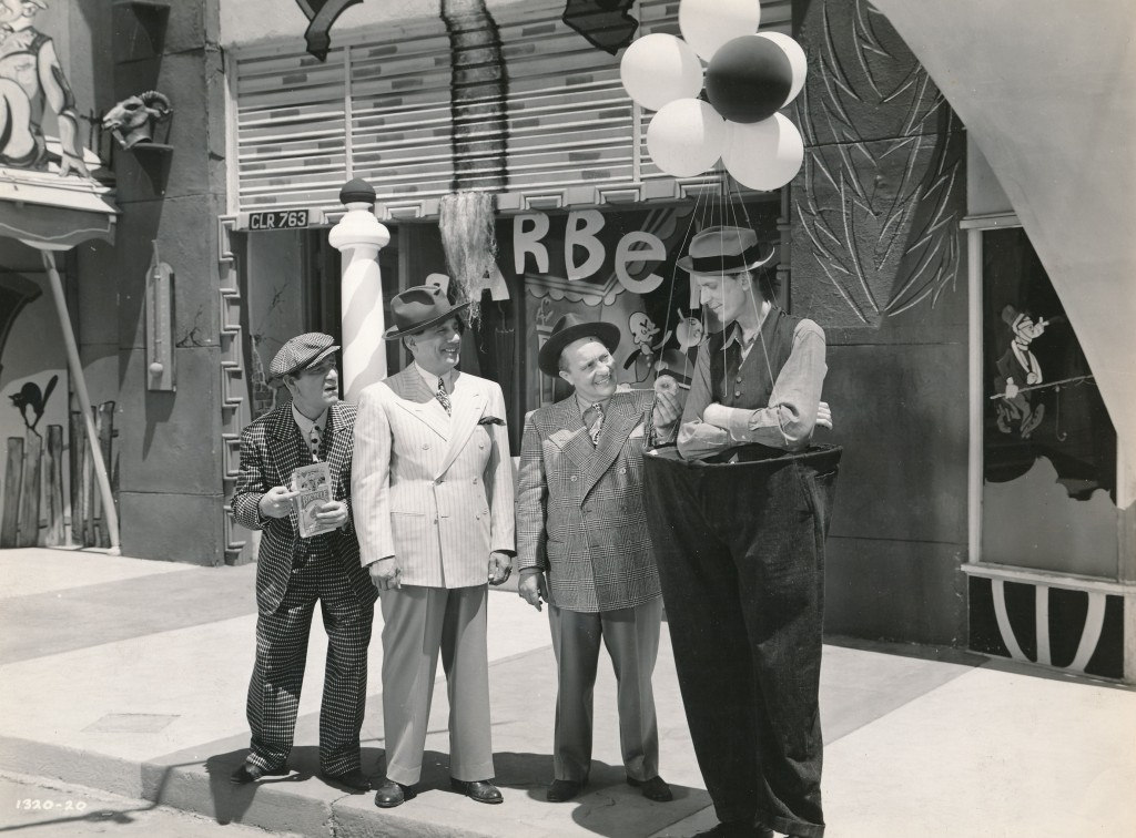 Shemp had a part in the 1943 Universal film, 'Crazy House,' which is one of Quentin Tarantino's favorite films. The gents wearing the wide-lapelled suits are the comedy team of Ole Olson and Chic Johnson. 'Crazy House' was based on their hit Broadway review. (c) Universal