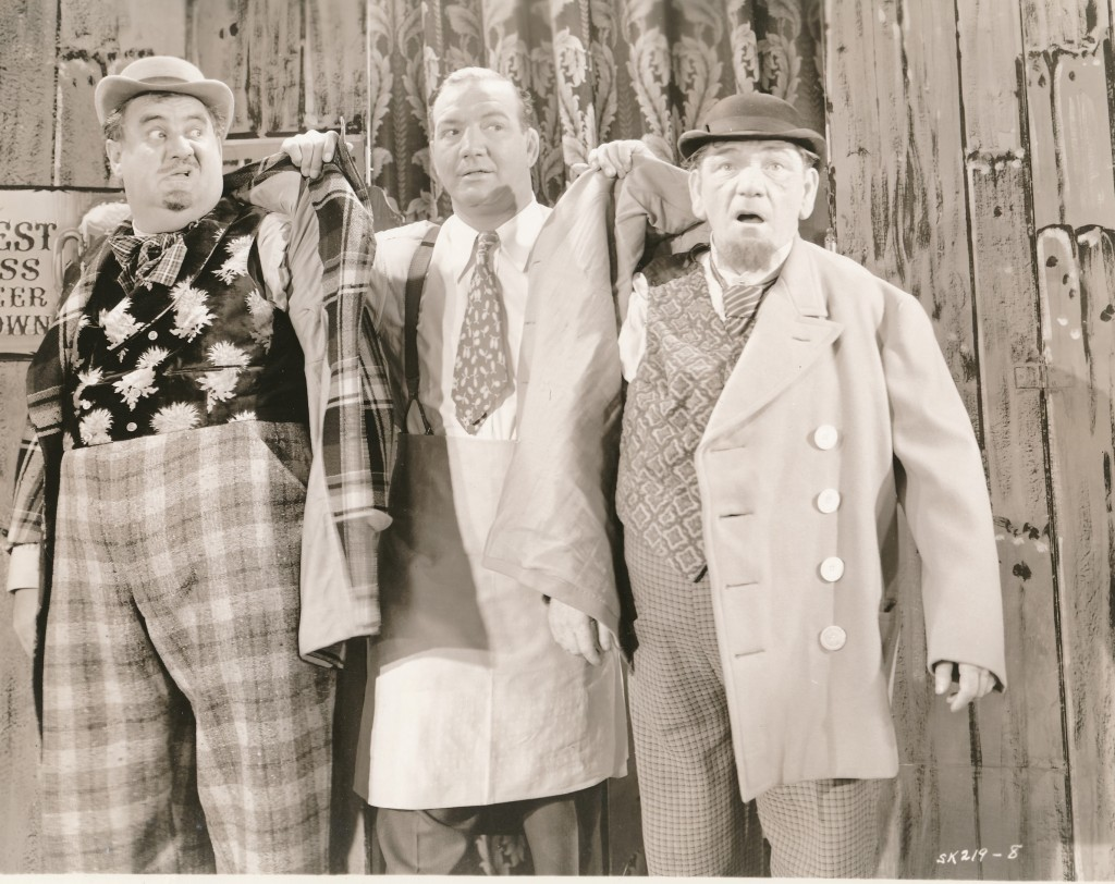 This still is from 'Three of a Kind,' a 1944 epic from Monogram Studios. That's rotund comedian Billy Gilbert on the left, with Shemp on the opposite side. The gent preparing to give them the bum's rush is Max 'Slapsie Maxie' Rosenbloom. 'Slapsie' was a popular boxer who parlayed his sports fame into a career playing character roles in movies. (c) Monogram
