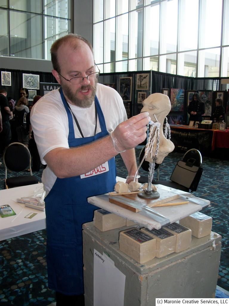 Spectrum 2014 was not just a collection of artists sitting behind tables. There were demonstrations of sculpting, painting and other media during the weekend. Jarrod Shifflitt takes a creature creation all the way from concept to completion.