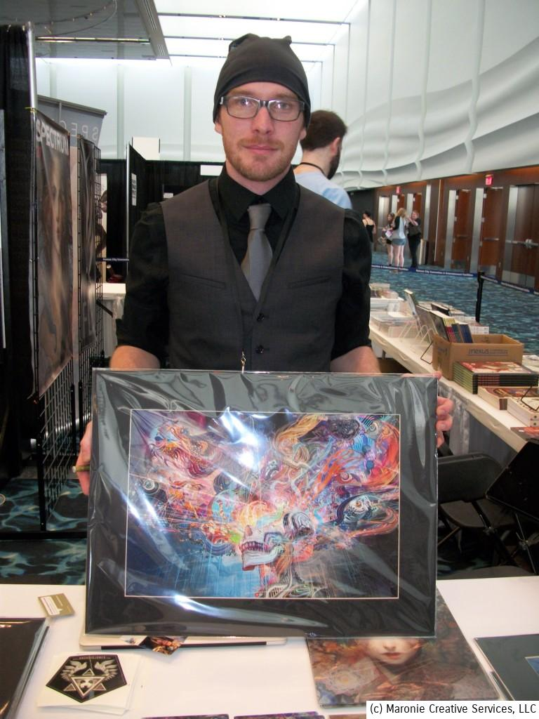 You just gotta love an artist who's named Android Jones! Here AJ displays one of his colorful masterpieces.