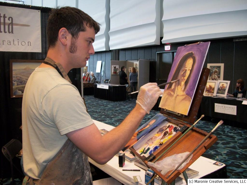 Colin Nitta paints and demonstrates his skill during the show. He makes it look easy, doesn't he?