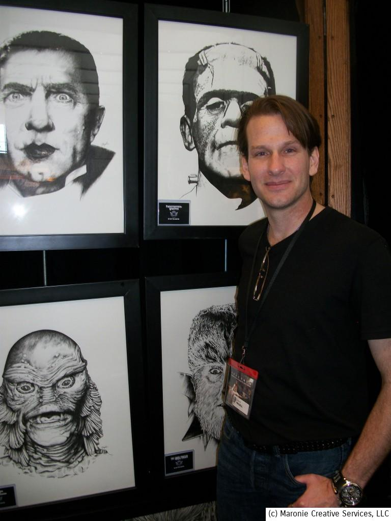 David Frizell poses in front his realistic take on the classic Universal Monsters.