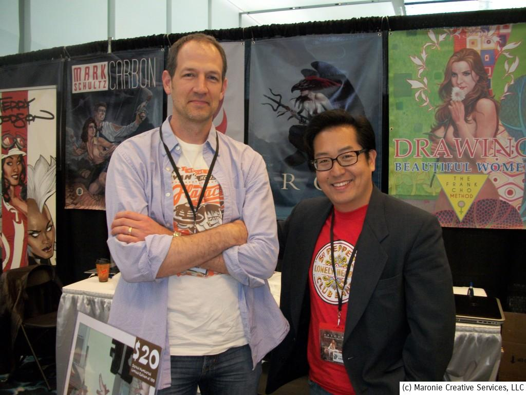 Artists Terry Dodson and Frank Cho take a moment for an exclusive pose for SMEF.  They both had a steady stream of admirers throught the show.