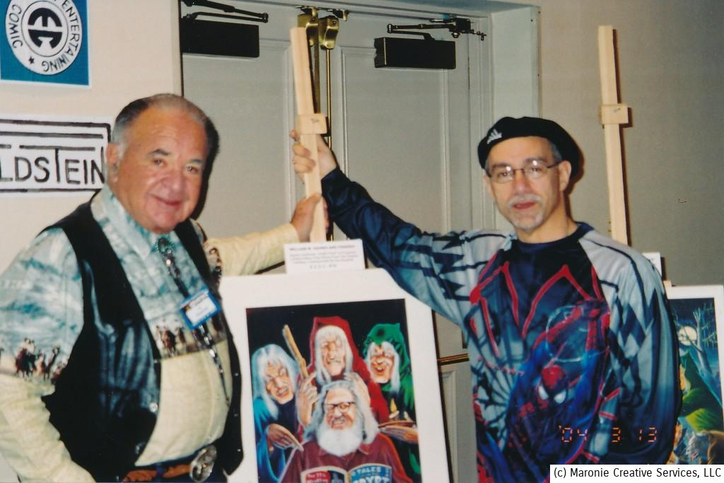 Blogmeister Sam poses with Al Feldstein and one of the artist's paintings. This effort depicts EC publisher William Gaines, surrounded by the three horror hosts who were featured in their iconic horror comics.