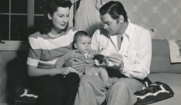 The picture of domestic bliss! Johnny Weissmuller and his 'Jane,' wife Beryl, pose with young John Scott. The tyke is one of three children the actor had during his marriage to Beryl.