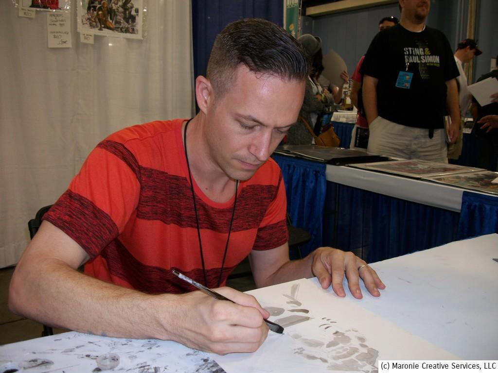 Spider-Man artist Kaare Andrews sketches for fans. Andrews has pencilled adventures of The Hulk and Wolverine and is now branching out into film-making.