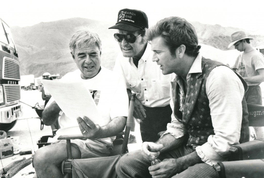 Here Garner confers with director Richard Donner and co-star Mel Gibson between takes of the 1994 feature film, Maverick. Gibson portrayed Bret Maverick in this updating of the popular TV series. (c) Warner Brothers
