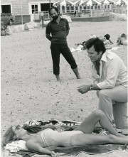 This scene is from a 1978 episode of Garner's popular detective series, The Rockford Files. That's guest-star Kathryn Harrold on the ground. Co-star Stuart Margolin stands in the background. (c) NBC