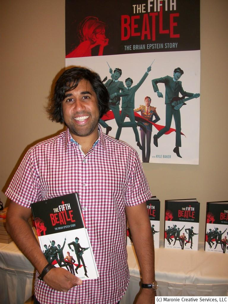 Author Vivek J. Tiwary poses with his Eisner Award-winning graphic novel, 'The Fifth Beatle' during Chicago's Beatlefest 2014. The writer/producer/director is now at work on the film version of his best-selling work.