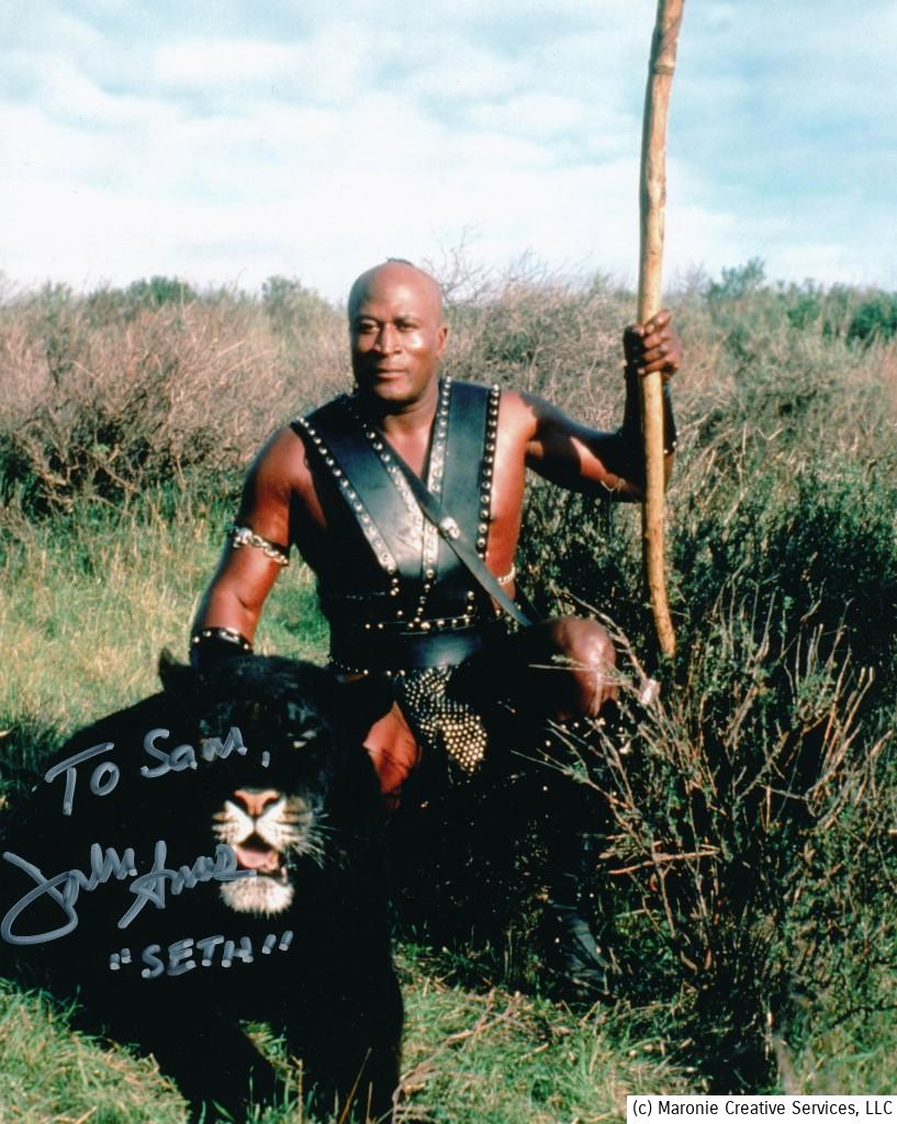 This is a signed photo of Mr. Amos from the 1982 cult classic, 'Beastmaster.' Marc Singer, Tanya Roberts and Rip Torn co-starred in this successful exploitation epic. (c) Columbia Pictures