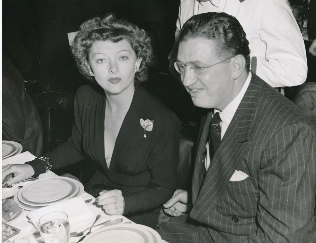 This 1943 photo features Myrna Loy dining out with uber-producer David O. Selznick at a Hollywood restaurant.