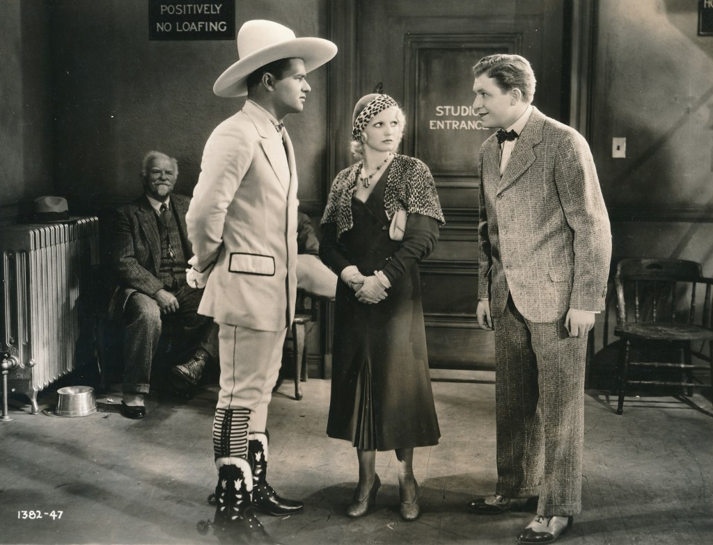 This rare still is from the 1932 Paramount production, 'Make Me A Star.' That's perennial bumpkin Stu Erwin on the far right, with actress Joan Blondell in the middle. I'm not sure who the actor on the left is, but he's sporting some out-of-this-world footwear! (c) Paramount