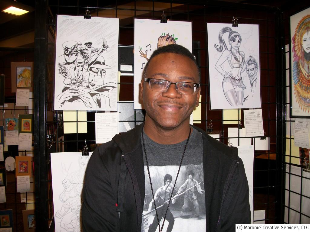 Artist Lorenzo Lizana poses in the Art Room in front of his work.