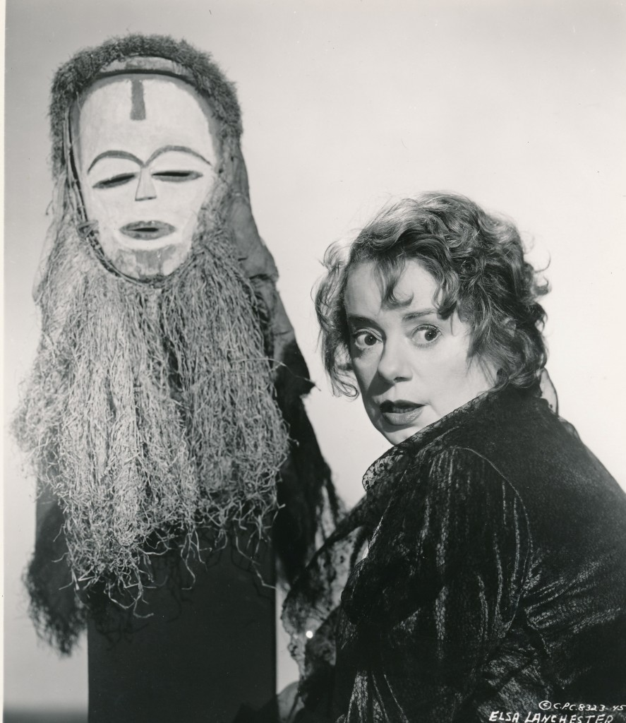 Elsa Lanchester only portrayed one true monster, but it was a classic! Here the former 'Bride of Frankenstein' poses with a voodoo mask from the 1958 film, 'Bell, Book and Candle.'  What a great character she was! (c) Columbia Pictures