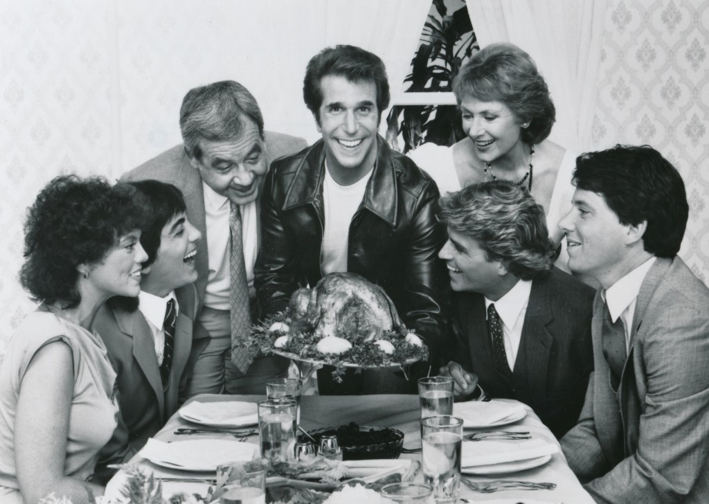 The Cunninghams from 'Happy Days' pose for a highly-retouched 1983 Thanksgiving photo. Left to right are Erin Moran, Scott Baio, Tom Bosley, Henry Winkler, Marian Ross, Steven Shortridge and Anson Williams. What? No Ralph Malph? (c) ABC