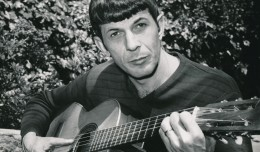 This is a piece of early 'Star Trek' publicity that shows the more human side of everyone's favorite Vulcan. Nimoy is obviously at home, grokking on a filk tune or two. (c) NBC