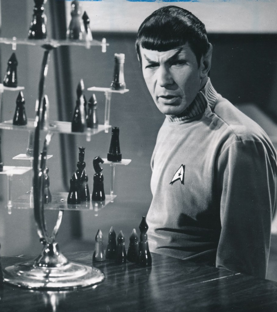 Nimoy's 'Spock' engages in a high-level game of three-dimensional chess. The costume and make-up design in this still indicate this photo was taken during production of the second pilot film. (c) NBC