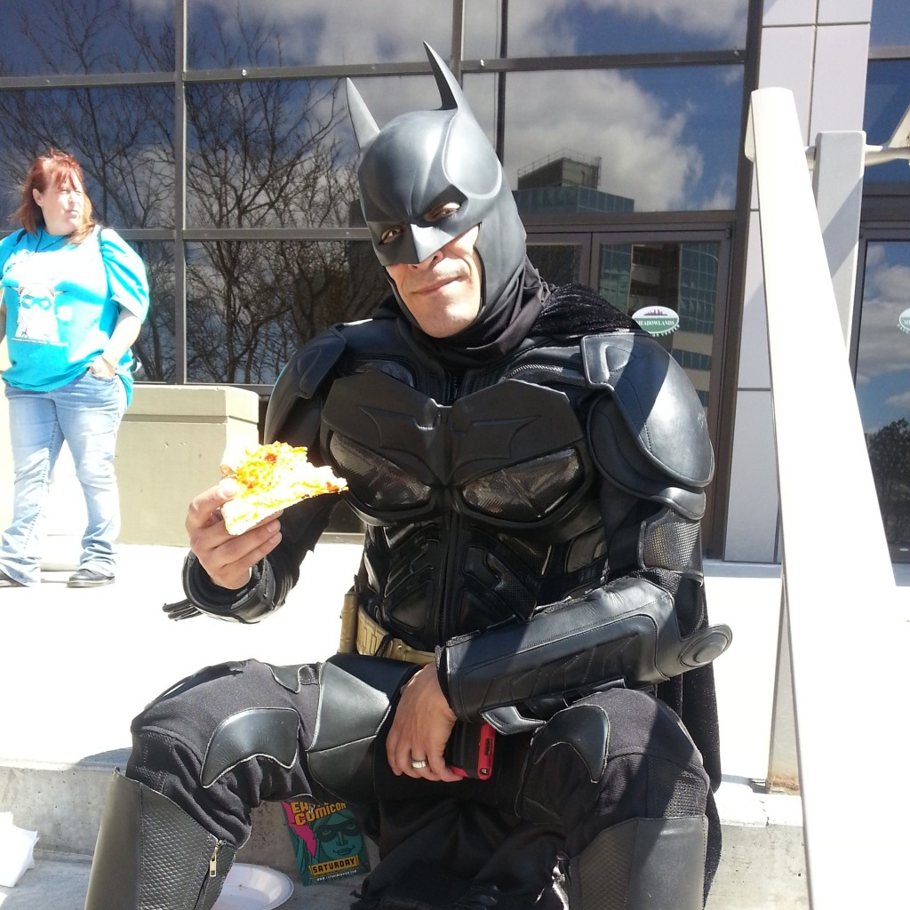 On the steps of The Meadowlands in Secaucus, NJ. Even the Caped Crusader has to take a lunch break! I wonder if loyal Afred hand-tossed that pie Batman is chowing down on?