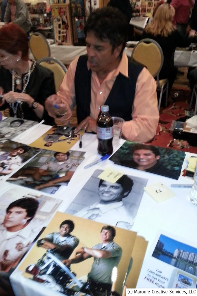 Erik Estrada had a steady stream of fans lining up to buy his autograph. Women in their 50s were the major purchasers and gurgled with joy upon seeing their 1970s idol.