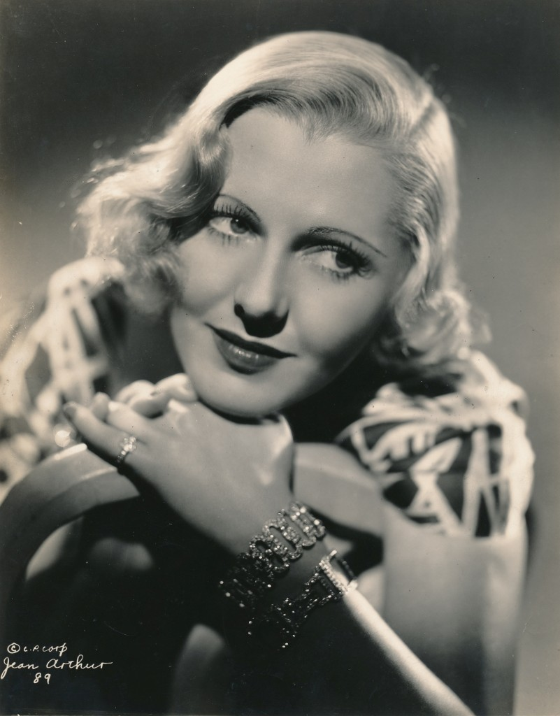 This glamorous portrait still of actress Jean Arthur is from another 1935 picture, Public Hero No. 1. A penciled note scrawled on the back of the photo remarks that the World Premiere of this film is to take place May 30 at Loew's State Theater in St. Louis. The old movie palace has been long-gone. I wonder if Miss Arthur and co-star Lionel Barrymore were in attendance? (c) Columbia Pictures